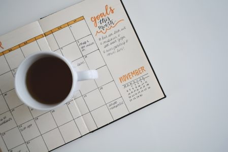 coffee mug with goal-setting calendar